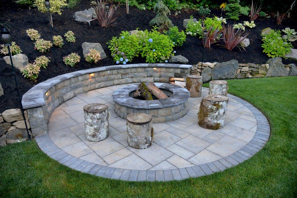 An outdoor entertainment area centered around a fire pit
